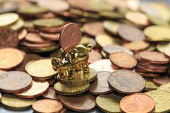 A piggy bank and euro cent - stock photo