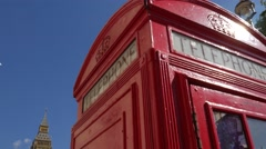 Tilt down a red telephone box with Big Ben behind Stock Footage