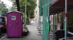 Street in Berlin with toilet porto potty, construction site, Berlin, Germany Stock Footage