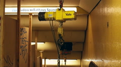 Portable crane in underground subway station, Berlin, Germany Stock Footage