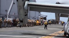 USS EDDEX COAST HAWAII, MAY 2015, US Marines On Aircraft Walk To Osprey Aircraft Stock Footage