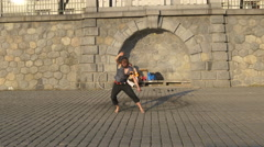 One man rotating fire balls on the waterfront in Prague Stock Footage