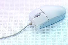 Binary code and computer mouse - stock photo