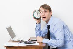manager shouts at the alarm clock - stock photo