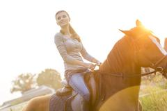 Woman horseback riding Stock Photos