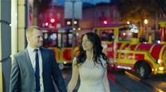 Just married couple walking night city Stock Footage
