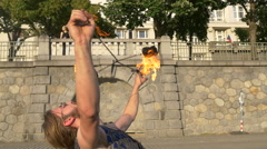 Fire dancer rotating fire balls on the waterfront in Prague Stock Footage
