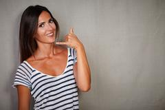 Waist up portrait of a good-looking woman gesturing customer service call - stock photo