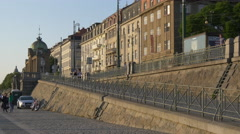 Walking near a small tower with cupola on Rasinovo waterfront, Prague Stock Footage