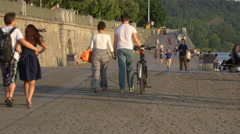 Couples walking on the waterfront in Prague Stock Footage