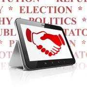 Stock Illustration of Political concept: Tablet Computer with Handshake on display