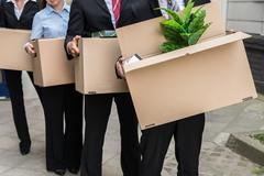 Close-up Of Unemployed Businesspeople Carrying Cardboard Boxes Stock Photos