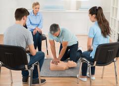 Male Instructor Teaching First Aid Cpr Technique To His Students Stock Photos