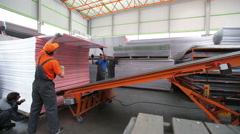 Workers Loaded Polycarbonate Sheets To The Tape Stock Footage