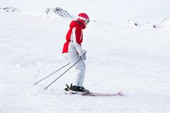 Female Skier At Ski Resort Solden In Oetztal Alps; Tirol; Austria - stock photo