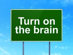 Stock Illustration of Learning concept: Turn On The Brain on road sign background