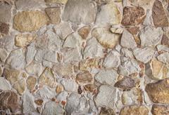masonry stone wall - stock photo