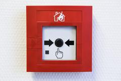 Button of the fire alarm system Stock Photos