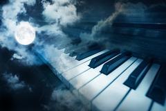 Piano keys in moonlight Stock Photos