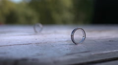 Wedding Rings At Wooden Table Stock Footage