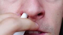 Man using nasal spray Stock Footage