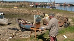 Newlyn Artist Painting Harbour - stock footage