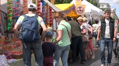 tourist people look after healthy ecologic products in outdoor fair. 4K - stock footage