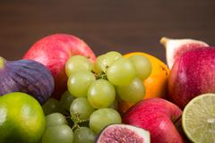 Assortment fruits on wooden table Stock Photos