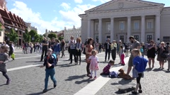 Cheerful people enjoy bubble blow in main square of Vilnius. 4K Stock Footage