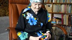 Senior woman with rubik's cube Stock Footage