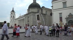 Catholic people families participate in religious procession. 4K Stock Footage