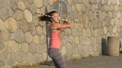 Girl hula hooping on the waterfront in Prague Stock Footage