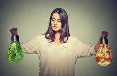 Woman thinking making diet choices junk food or green vegetables Stock Photos