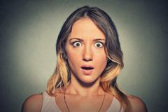 Stock Photo of Concerned scared shocked woman