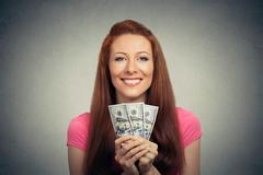 happy excited successful young business woman holding money dollar bills - stock photo