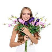 Beautiful happy woman with boquet of flowers Stock Photos