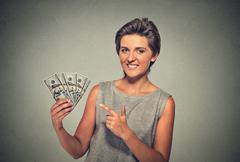 happy excited successful young woman holding money dollar bills - stock photo