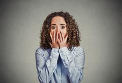 Stock Photo of Concerned scared woman
