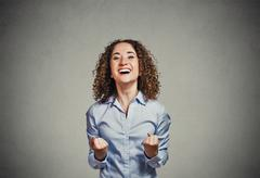 happy woman exults pumping fists ecstatic celebrates success screaming - stock photo