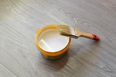 Bank with white paint and brush on  floor Stock Photos
