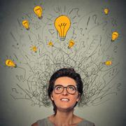 thinking woman with question signs and light idea bulb above head - stock photo
