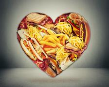 Heart and bad diet stroke risk concept. Heart shaped of fast junk fatty food - stock illustration