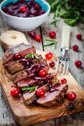 beef meat with homemade cranberry sauce - stock photo