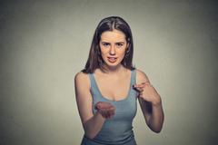 Woman gesturing with hand palms up to pay back now bills money Stock Photos