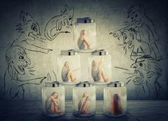 Lack, violation of human rights. Young lonely woman sitting in a pile of glas Stock Photos