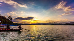 Stock Video Footage of Timelapse Heavenly Sunset. Cheow Lan Lake or Rajjaprabha Dam Reservoir, Thailand