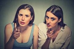 Upset angry two women pointing finger an you camera Stock Photos