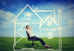 A safe house. Happy young woman enjoying her day in a new home - stock photo