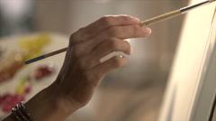 Close up of hand making brush strokes - stock footage