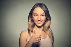 Gorgeous young woman showing giving thumbs up Stock Photos